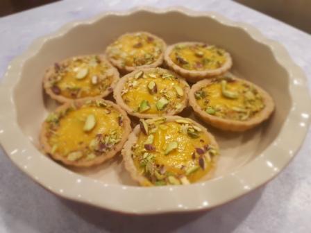 This Rakshabandhan Gift a Red Bake Bowl with Lemon Tarts from INDULGENCE